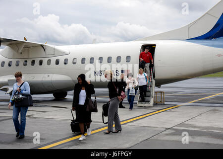Tennessee Blountsville Tri City Airport Black woman women airline airplane passengers deplane runway arrival carry - Stock Photo