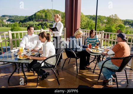 Tennessee Sevierville Kodak Chop House restaurant man men woman women couple young adults group waitress server - Stock Photo