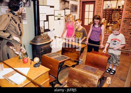 Wisconsin Kenosha Simmons Island Southport Kenosha History Center Yesteryear Gallery boy girl student one-room schoolhouse - Stock Photo
