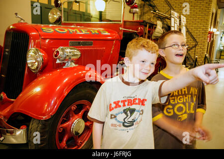 Wisconsin Kenosha Simmons Island Southport Kenosha History Center Yesteryear Gallery boy red fire engine truck redhead - Stock Photo