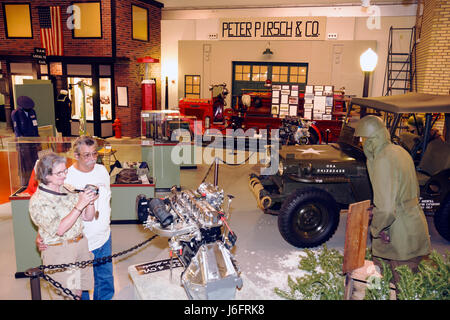 Wisconsin Kenosha Simmons Island Kenosha History Center Yesteryear Gallery man woman couple WWII jeep engine soldier - Stock Photo