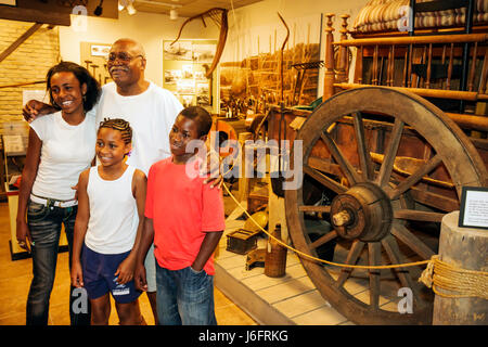Wisconsin Kenosha Simmons Island Kenosha History Center Yesteryear Gallery Black man girl boy teen father. child - Stock Photo