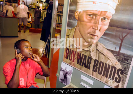 Wisconsin Kenosha Simmons Island Kenosha History Center Black boy WWII World War Two war bonds poster education - Stock Photo