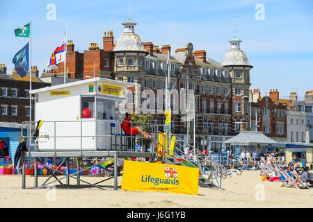 Weymouth, Dorset, UK. 21st May 2017.   UK Weather.   RNLI Lifeguards post on the beach on a warm sunny day at the - Stock Photo