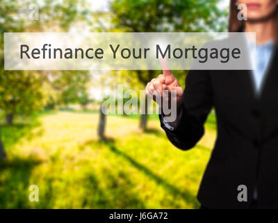 Refinance Your Mortgage - Businesswoman hand pressing button on touch screen interface. Business, technology, internet - Stock Photo