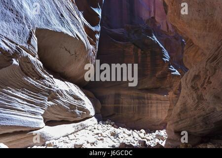 Hiking Buckskin Gulch Slot Canyon in South Utah - Stock Photo