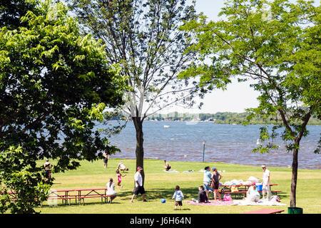 Wisconsin Kenosha Silver Lake Silver Lake Park picnic bench man men woman women boy girl child family summer vacation - Stock Photo