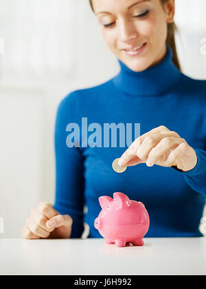woman bank lending institution euro coin one piggybank piggy woman bank lending - Stock Photo