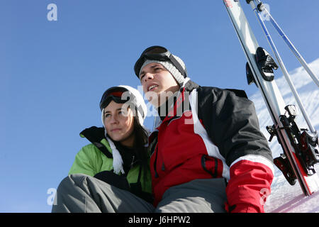 woman close profile friendship winter ski skiing put sitting sit observing - Stock Photo
