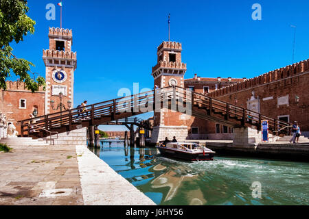 Arsenale,Venice, Italy - Entrance to the Naval Arsenal with Clock towers and and tourists crossing bridge over Rio - Stock Photo
