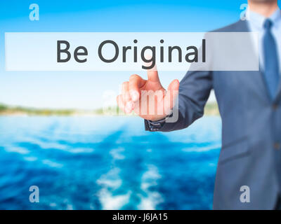 Be Original - Businessman hand pressing button on touch screen interface. Business, technology, internet concept. - Stock Photo