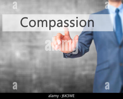 Compassion - Businessman click on virtual touchscreen. Business and IT concept. Stock Photo - Stock Photo