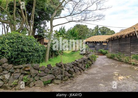 Folk Village in Jeju island, South Korea - Stock Photo
