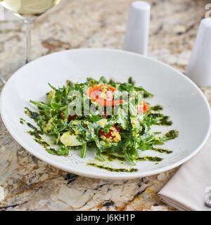 Salad with couscous, cherry tomatoes, avocado and mozzarella - Stock Photo