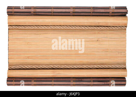 Bamboo mat with curled edges and rope, isolated on white background. View from above - Stock Photo