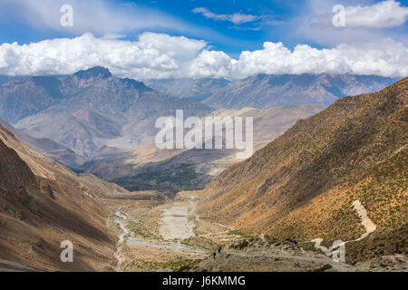 The way down from Thorong La pass. Beautiful mountain landscape in lower Mustang District, Nepal. - Stock Photo