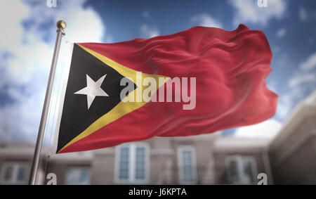 East Timor Flag 3D Rendering on Blue Sky Building Background - Stock Photo