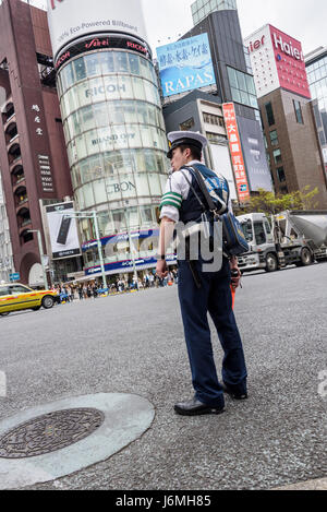Japanese policeman on traffic control. - Stock Photo