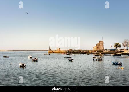 Porto, Portugal - Fishing boats on the river Douro with the Capela e Farol de Sao Miguel-o-Anjo in the background - Stock Photo