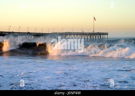 beach seaside the beach seashore waves coast pier storm salt water sea ocean - Stock Photo