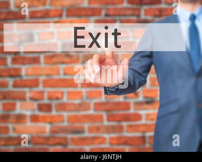 Exit - Businessman hand pressing button on touch screen interface. Business, technology, internet concept. Stock - Stock Photo