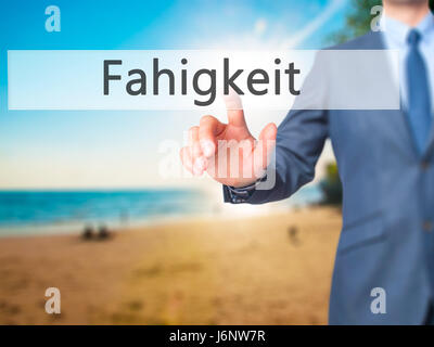 Fahigkeit (Ability in German) - Businessman hand pressing button on touch screen interface. Business, technology, - Stock Photo