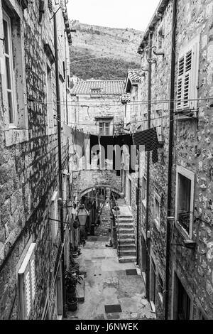 Looking down on a narrow but pretty street in the heart of the old town area of Dubrovnik in South Croatia.  Most - Stock Photo