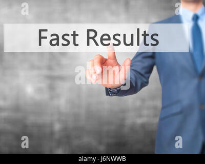 Fast Results - Businessman hand pressing button on touch screen interface. Business, technology, internet concept. - Stock Photo