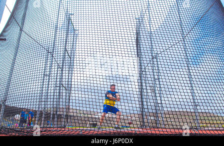 middle-aged man throwing the hammer inside a net cage in the CIAT Tenerife - Stock Photo