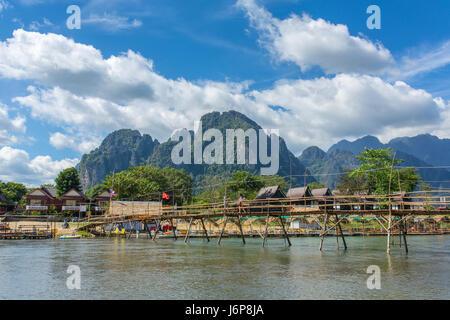 Wooden bridge across Nam Song river at Vang Vieng, Laos - Stock Photo