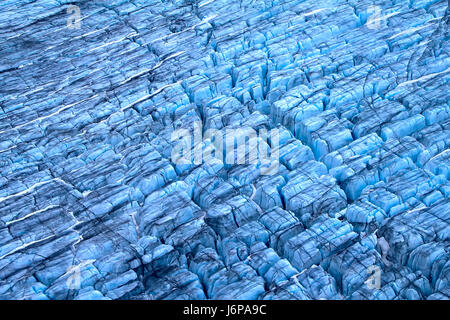 Harsh glaciers of Arctic. Live glacier, fractured surface, nested snowfields and age-old dust. Novaya Zemlya archipelago, - Stock Photo