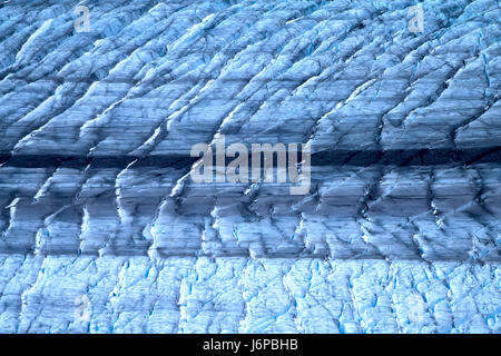 Harsh glaciers of Arctic. Live glacier, surface traces of glacial denudation (erosion river from nunatak). Novaya - Stock Photo