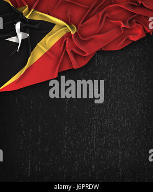 East Timor Flag Vintage on a Grunge Black Chalkboard With Space For Text - Stock Photo