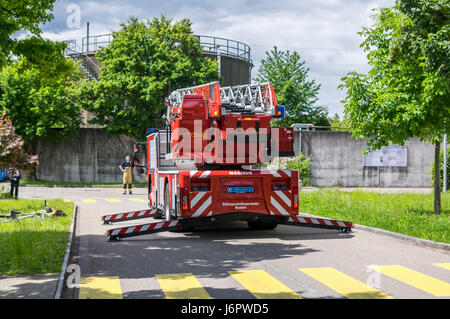 Rear view of an Iveco Magirus 160E30 turntable ladder truck of a Swiss fire brigade. Outriggers/jacks extended, but ladder still retracted.