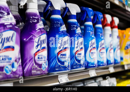 Bottles of Lysol spray cleaners on a grocery store shelf - Stock Photo