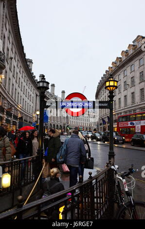 people walking up steps of Piccadilly Circus underground station on to Regent Street, London, UK - Stock Photo