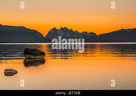 Gulf Almirante Montt,Puerto Natales, Chile - Pacific Ocean waters in Chile, Patagonia, Magallanes Region at sunset - Stock Photo