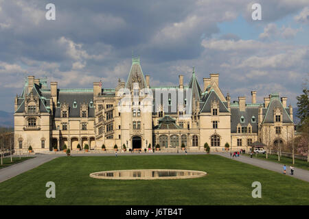 Biltmore House at the Biltmore Mansion in Asheville, North Carolina.  Sun on the house and clouds in the sky. - Stock Photo