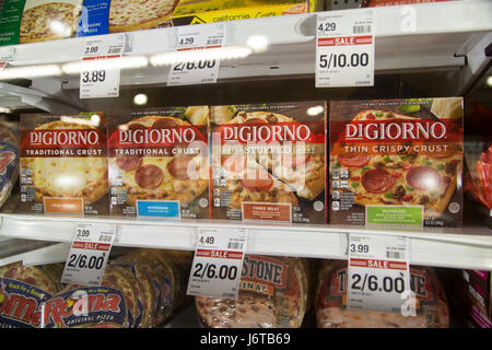A Display Of Digiorno Frozen Pizzas In A Glass Freezer Case At A