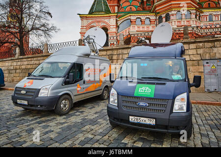 Moscow - 10.04.2017: Two broadcast vehicles parking near Kremlin in Moscow - Stock Photo