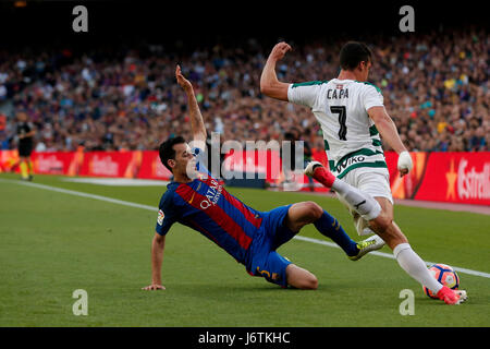 Barcelona, Spain. 21st May, 2017. Barcelona's Sergio Busquets (L) vies with Eibar's Capa during the Spanish first - Stock Photo