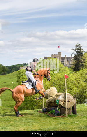 Rockingham Castle, Corby, UK. 21st May, 2017. Richard P Jones and his horse Killaboy Bob clear a log obstacle with - Stock Photo
