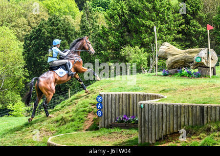 Rockingham Castle, Corby, UK. 21st May, 2017. Izzy Taylor and her horse Zippi Jazzman run uphill towards a log obstacle - Stock Photo