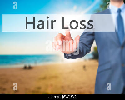 Hair Loss - Businessman hand pressing button on touch screen interface. Business, technology, internet concept. - Stock Photo