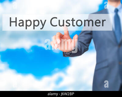 Happy Customer - Businessman hand pressing button on touch screen interface. Business, technology, internet concept. - Stock Photo