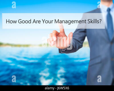 How Good Are Your Management Skills - Businessman hand pressing button on touch screen interface. Business, technology, - Stock Photo