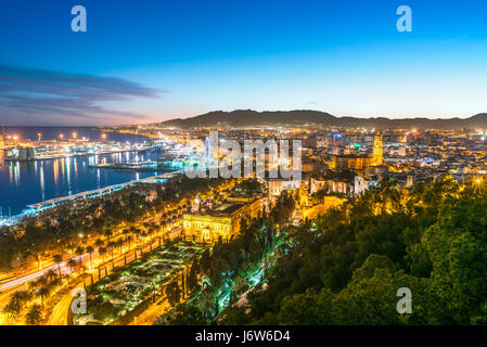 Malaga Old Town Cathedral and Port Harbour Harbor scenic view at sunset twilight dusk evening Malaga Spain. From - Stock Photo