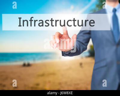 Infrastructure - Businessman hand pressing button on touch screen interface. Business, technology, internet concept. - Stock Photo