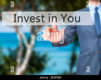 Invest in You - Businessman hand pressing button on touch screen interface. Business, technology, internet concept. - Stock Photo