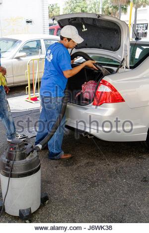 Miami Florida Little Havana car wash vacuum Hispanic man job - Stock Photo